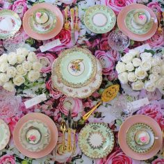 Mint green vintage tea cup sets with pink entree plates and gold plated cutlery.