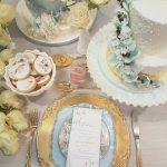 Vintage dinnerware, gold cutlery, chargers and milk glass pedestal stand, styling and cakes from The Garnished Co.
