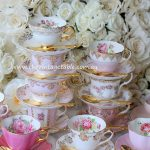 A Pink & Gold Tea Station with Gold Plated Teaspoons