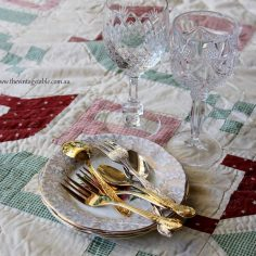 Vintage Picnic Rug, cake plates, wine glasses and gold cutlery