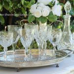 Vintage mismatched cut crystal wine glasses, silver trays & crystal decanters.