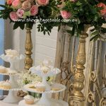 Stacked Vintage Milk Glass Pedestals & our large gold Candle Holders - used here with flowers.