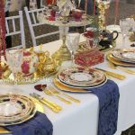 Heirloom Collection Dinnerware with gold cutlery and gold charger plates